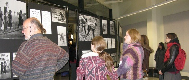 Visitors viewing Visible Work, Invisible Women: Women & Work in Rural India exhibition by P. Sainath, Edmonton