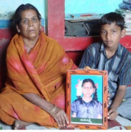 Jayalakshmi Palem (in the framed photograph) was 12 years old when she committed suicide on learning she would have to drop out of school as her father could no longer pay the fees. Her grandmother Mangamma and younger brother Somashekar at their home in Anantapur district.