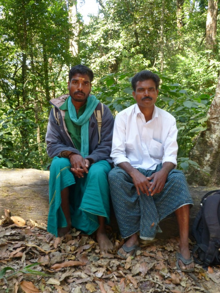 villagers on an elephant hunt sitting in the forest