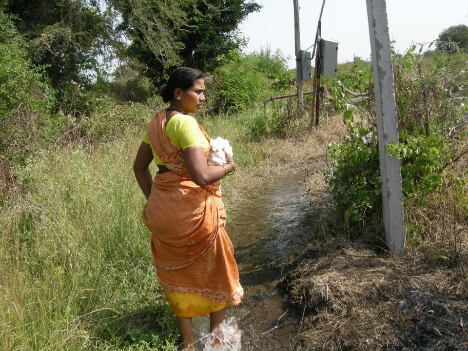 Farmer suicide widow walking on rural path