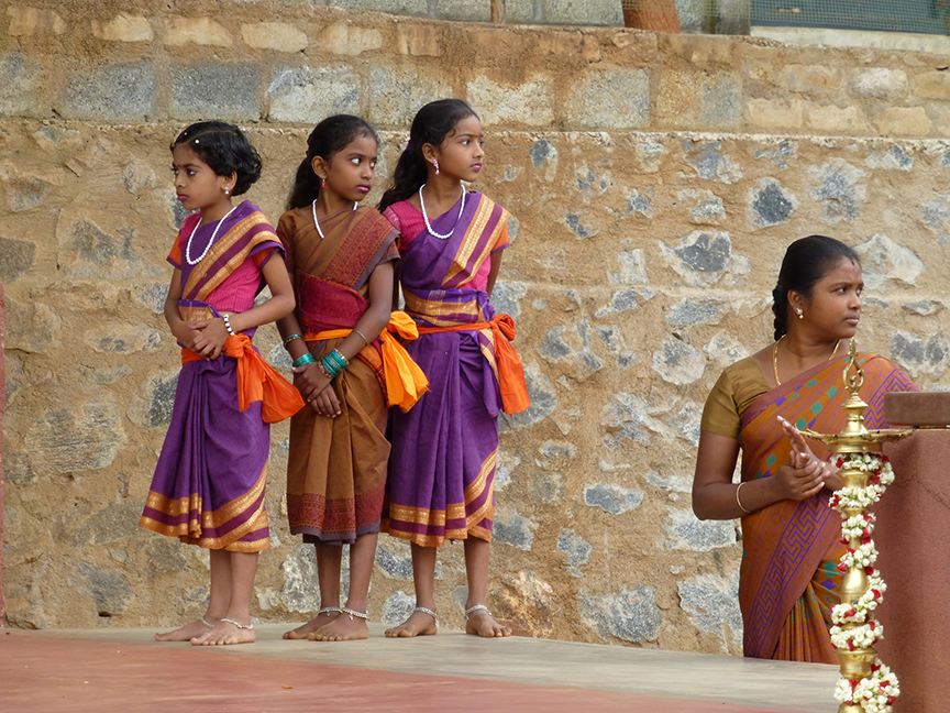 girl students ready to perform on stage